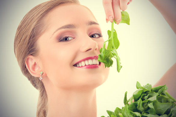 Happy-woman-eating-Spinach